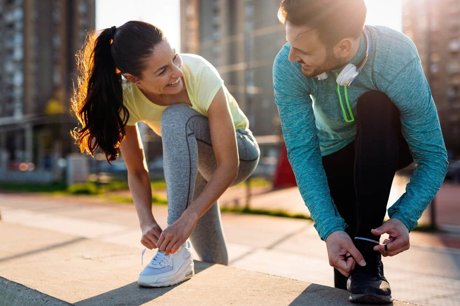 man and woman smiling while exercising
